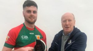 Salthill Men's A Champion: Fergal Coughlan Jnr receives trophy from Pierce Lawlor, Salthill Handball Club.